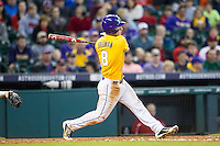 LSU Tigers shortstop Alex Bregman (8) follows through on his swing during the Houston College Classic against the Nebraska Cornhuskers on March 8, 2015 at Minute Maid Park in Houston, Texas. LSU defeated Nebraska 4-2. (Andrew Woolley/Four Seam Images)