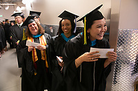 Tanya Komakhuk, M.P.A. Public Administration, waits excitedly in the wings before entering the arena to receive her degree during UAA's 2019 Fall Commencement at the Alaska Airlines Center.