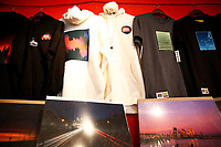 """Prints, sweatshirts, and t-shirts are shown on sale at """"Proper Nouns', a photography show by Justin Boyd, at Bankrupt Bodega in the Bloomfield neighborhood on Friday September 3, 2021 in Pittsburgh, Pennsylvania. (Photo by Jared Wickerham/Pittsburgh City Paper)"""