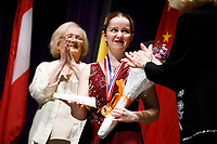 First prize winner Melanie Laurent from France receives flowers during the awards ceremony of the 11th USA International Harp Competition at Indiana University in Bloomington, Indiana on Saturday, July 13, 2019. (Photo by James Brosher)