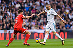 Karim Benzema of Real Madrid (R) dribbles Clement Lenglet of Sevilla FC (L) during La Liga 2017-18 match between Real Madrid and Sevilla FC at Santiago Bernabeu Stadium on 09 December 2017 in Madrid, Spain. Photo by Diego Souto / Power Sport Images