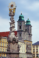 Linz, Austria, The Danube Valley, Oberosterreich, Pillars of the Holy Trinity at Hauptplatz and Old Cathedral in downtown Linz.