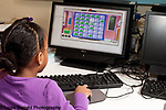 Education preschool 3-4 year olds girl playing game on desktop computer