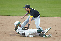 Gino Groover (23) of the Charlotte 49ers slides into second base ahead of the tag by Luke Drumheller (4) of the Appalachian State Mountaineers at Atrium Health Ballpark on March 23, 2021 in Kannapolis, North Carolina. (Brian Westerholt/Four Seam Images)