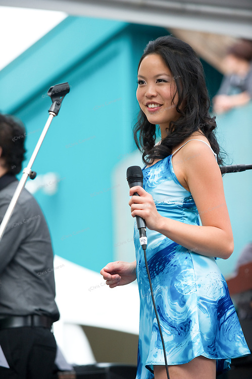Kristen Fung singing at Granville Island