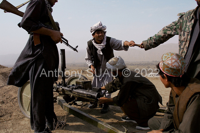 Khogebha Hoddin, Northern Afghanistan <br /> October 2001<br /> <br /> The Northern Alliance prepares an old canon at the front lines with the Taliban near Khogebha Hoddin.