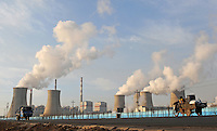 Smoke spews from a power plant on the edge of Baotau in China's Inner Mongolian Province. China still relies heavily on coal power and is a major producer of green-house gases, and has been asked to reduce greenhouse gases emissions by 40-45 percent by 2020 if its 2005 level.