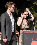 Robert Pattinson and Kristen Stewart attends the  TWILIGHT : Kristen Stewart, Robert Pattinson And Taylor Lautner Hand And Footprint Ceremony held at The Grauman's Chinese Theatre in Hollywood, California on November 3,2011                                                                               © 2011 DVS / Hollywood Press Agency