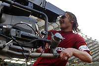 Roma 21/4/2004 Campionato Italiano Serie A <br /> Lazio - Roma 1-1 <br /> Francesco Totti festeggia il gol del pareggio con la telecamera.<br /> Roma's striker Francesco Totti plays with a TV camera after equalizing by a penalty kick during the Italian top league soccer match between Lazio and Roma at Rome's Olympic stadium, Wednesday, April 21, 2004<br /> Lazio and Roma are playing again after it was suspended on March 21, 2004, for security reasons.  <br /> Foto Andrea Staccioli Insidefoto