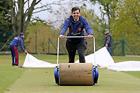 Joe Ellis-Grewal of Wanstead CC attempts to dry the playing area after heavy rain fell ahead of Wanstead and Snaresbrook CC vs Hornchurch CC, Hamro Foundation Essex League Cricket at Overton Drive on 8th May 2021