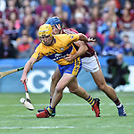 Colm Galvin of Clare in action against Johnny Coen of Galway during their All-Ireland semi-final at Croke Park. Photograph by John Kelly.