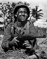 Marine awaits signal to go ahead in battle to recapture Guam from Japs.  July 1944. Lt. Paul Dorsey. (Navy)<br /> Exact Date Shot Unknown<br /> NARA FILE #:  080-G-475159<br /> WAR & CONFLICT BOOK #:  1194