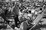 Blackpool Beach Lancashire Uk. 1970s. Holidaymakers sun themselves crowded beach. ..