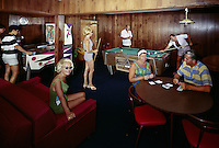 Shooting pool & playing cards in the motel game room. 1960's.