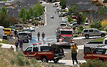 Residents watch as firefighters battle multiple brush fires caused by lightning in south Douglas County Friday afternoon, June 1, 2012. Houses in the Ray May subdivision off Highway 395 south of Gardnerville were initially threatened. .Photo by Cathleen Allison