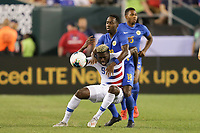 PHILADELPHIA, PENNSYLVANIA - JUNE 30: Gyasi Zardes #9, Elson Hooi #18 during the 2019 CONCACAF Gold Cup quarterfinal match between the United States and Curacao at Lincoln Financial Field on June 30, 2019 in Philadelphia, Pennsylvania.