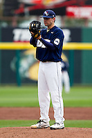 Alec Smith (8) of the Oral Roberts Golden Eagles reads the pitching sign during a game against the Missouri State Bears on March 27, 2011 at Hammons Field in Springfield, Missouri.  Photo By David Welker/Four Seam Images