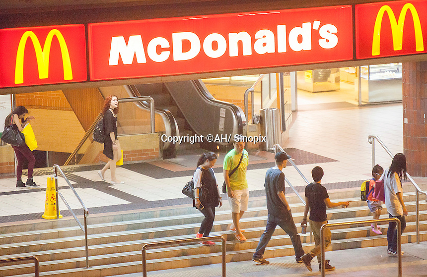 Fugitive rapist Joseph Tsang (in black T-shirt, third from right) walks to McDonald's restaurant the day before his arrest at Lei Tung Estate, Ap Lei Chau, Hong Kong, China, 24 September 2015. Joseph Tsang was charged and convicted of raping underage girls and possession of child pornorgaphy by Oxford Crown Court in August, but skipped bail to flee to his native Hong Kong before sentencing.
