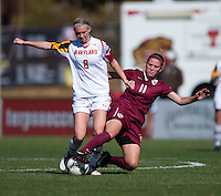Ashley Spivey (8) of Maryland pushes through the tackle of Isabella Schmid (11) of Florida State during the game at Ludwing Field in College Park, MD.  Florida State defeated Maryland, 1-0.