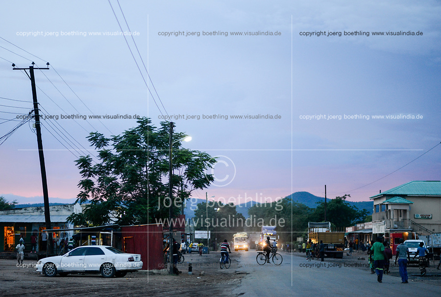 SAMBIA, Sinazongwe District, town Sinazese, main road at evening, trucks transport coal from Collum coal mine