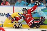 Billy Bridges, Vancouver 2010 - Para Ice Hockey // Para-hockey sure glace.<br /> Team Canada plays against Sweden in Para Ice Hockey action // Équipe Canada joue contre la Suède dans un match de para-hockey sur glace. 14/03/2010.
