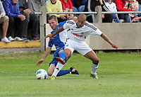 Pictured: Casey Thomas of Swansea (R) tackled by Paul Keddle (L) of Port Talbot. Saturday 17 July 2011<br />