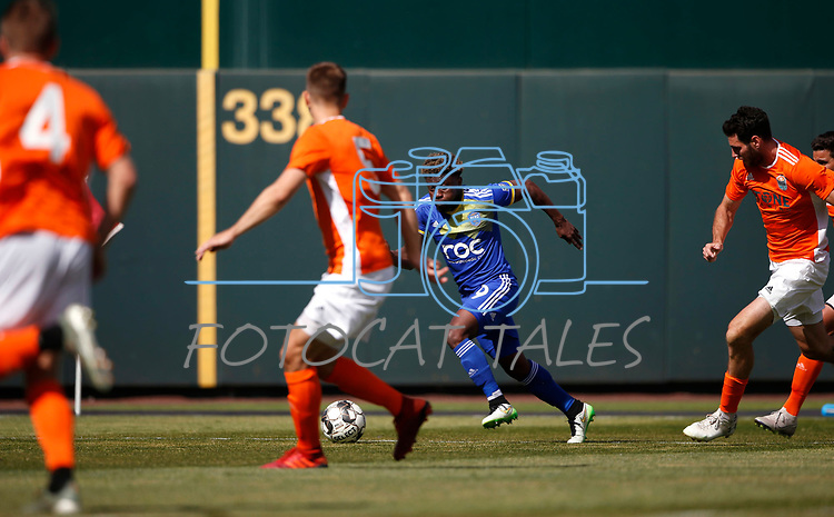 Reno 1868 midfielder Christiano Fracois runs up the field against San Diego Loyal SC during a preseason match in Reno, Nev., on Saturday, Feb. 29, 2020. San Diego won 4-2. <br /> Photo by Cathleen Allison/Cathleen Allison Photography