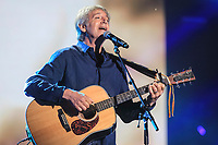 Yves Duteil performs during the Hommage a Felix Leclerc concert at the Festival d'ete de Quebec on the plains of Abrahams in Quebec City Thursday July 3, 2014.