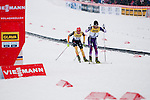 HOLMENKOLLEN, OSLO, NORWAY - March 16: (R-L) Yoshito Watabe of Japan (JPN) and Johannes Rydzek of Germany (GER) during the cross country 15 km (2 x 7.5 km) competition at the FIS Nordic Combined World Cup on March 16, 2013 in Oslo, Norway. (Photo by Dirk Markgraf)