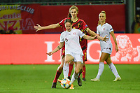 Swiss Geraldine  Reuteler (6) and Belgian Marie Minnaert (16)  pictured during a female soccer game between the national teams of Belgium , called the Red Flames and Switzerland on the 8 th and last matchday in group H for the qualification for the Womens EURO 2022 in England , on Tuesday 1 th of December 2020  in Leuven , Belgium . PHOTO SPORTPIX.BE   SPP   DIRK VUYLSTEKE