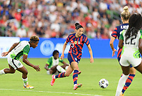 AUSTIN, TX - JUNE 16: Christen Press #23 of the United States dribbles the ball around Rita Chikwelu #10 of Nigeria during a game between Nigeria and USWNT at Q2 Stadium on June 16, 2021 in Austin, Texas.