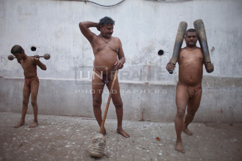 Pehlwani (traditional Indian wrestlers) practice using traditional Kushti equipment. Nowadays, there are a few wrestlers remained that choose to play traditional Kushti wrestling in the mud rather than on the mat or on the turf. Kolkata, India.