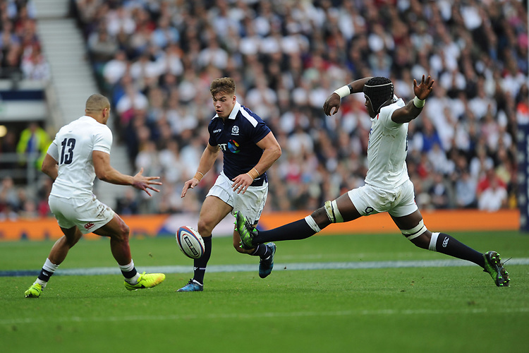 Huw Jones of Scotland chips through Jonathan Joseph and Maro Itoje of England during the RBS 6 Nations match between England and Scotland at Twickenham Stadium on Saturday 11th March 2017 (Photo by Rob Munro/Stewart Communications)