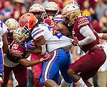 Florida State defensive back Jaiden Woodbey (20) and linebacker Dontavious Jackson (5) stop Florida running back Jordan Scarlett (25) in the 1st half of an NCAA college football game in Tallahassee, Fla., Saturday, Nov. 24, 2018. (AP Photo/Mark Wallheiser)