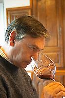 Christian Mocci Domaine de Mas de Martin, St Bauzille de Montmel. Gres de Montpellier. Languedoc. Owner winemaker. Tasting wine. France. Europe. Wine glass.