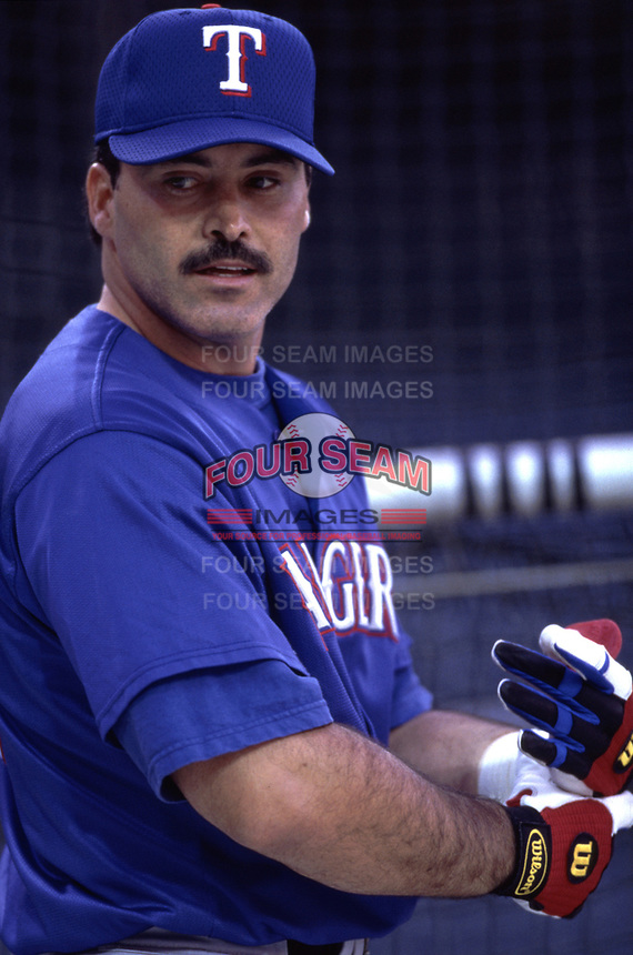 Rafael Palmeiro of the Texas Rangers during a 2000 season MLB game at Angel Stadium in Anaheim, California. (Larry Goren/Four Seam Images)
