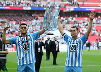 28th May 2018, Wembley Stadium, London, England;  EFL League 2 football, playoff final, Coventry City versus Exeter City; Maxime Biamou of Coventry City and Michael Doyle of Coventry City both lift the EFL League 2 trophy in front of the Coventry City fans