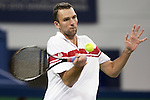 SHANGHAI, CHINA - OCTOBER 12:  Ivo Karlovic of Croatia returns a shot to James Blake of the US during day two of 2009 Shanghai ATP Masters 1000 at the Qi Zhong Tennis Centre in Shanghai. Photo by Victor Fraile / The Power of Sport Images