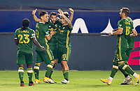 CARSON, CA - OCTOBER 07: Diego Valeri #8, Pablo Bonilla #28 and Felipe Mora #9 of the Portland Timbers celebrate a Timbers goal during a game between Portland Timbers and Los Angeles Galaxy at Dignity Heath Sports Park on October 07, 2020 in Carson, California.