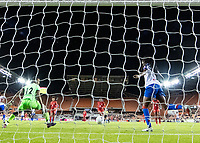 HOUSTON, TX - FEBRUARY 3: Goalkeeper Kerly Theus #12 looks on as her teammate Chelsea Surpris #3 of Haiti kicks a Panama shot off of the line during a game between Panama and Haiti at BBVA Stadium on February 3, 2020 in Houston, Texas.