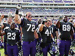 TCU Horned Frogs offensive tackle Bobby Thompson (72), TCU Horned Frogs safety Jonathan Anderson (41) and TCU Horned Frogs guard Trevius Jones (68) celebrate after the game between the Virginia Cavaliers and the TCU Horned Frogs  at the Amon G. Carter Stadium in Fort Worth, Texas. TCU defeats Virginia 27 to 7....