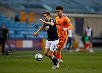 21st November 2020; The Den, Bermondsey, London, England; English Championship Football, Millwall Football Club versus Cardiff City; Murray Wallace of Millwall being marked by Kieffer Moore of Cardiff City