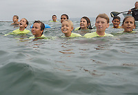 August 17 2015, Ocean Beach San Diego CA USA: San Diego Junior Lifeguards cheer on their team mates to have the courage to take a giant leap from the Ocean Beach Pier into the turbulent waters below.  The twice annual San Diego tradition is the culmination of weeks of training by the young guards, aged 9 to 16 years old.