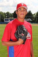 Williamsport Crosscutters pitcher Mario Hollands (43) poses for a photo in Phillies gear before a game vs the Batavia Muckdogs at Dwyer Stadium in Batavia, New York July 26, 2010.   Batavia defeated Williamsport 3-2.  Photo By Mike Janes/Four Seam Images