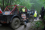 Repairing a Land Rover based off-road racer competing at the ALRC National 2008 CCVT trial during very bad weather. The Association of Land Rover Clubs (ALRC) National Rallye is the biggest annual motor sport oriented Land Rover event and was hosted 2008 by the Midland Rover Owners Club at Eastnor Castle in Herefordshire, UK, 22 - 27 May 2008. --- No releases available. Automotive trademarks are the property of the trademark holder, authorization may be needed for some uses.