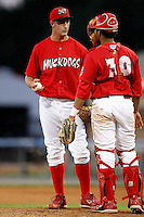 July 4, 2009:  Pitcher Deryk Hooker of the Batavia Muckdogs talks with catching Ivan Castro during a game at Dwyer Stadium in Batavia, NY.  The Muckdogs are the NY-Penn League Short-Season Class-A affiliate of the St. Louis Cardinals.  Photo By Mike Janes/Four Seam Images