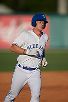 Dunedin Blue Jays Riley Adams (21) rounds the bases after hitting a home run during a Florida State League game against the Lakeland Flying Tigers on April 18, 2019 at Jack Russell Memorial Stadium in Clearwater, Florida.  Dunedin defeated Lakeland 6-2.  (Mike Janes/Four Seam Images)