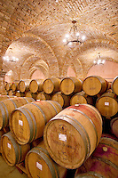 Wine aging in barrels in cellar. Castello di Amerorosa. Napa Valley, California. Property relased