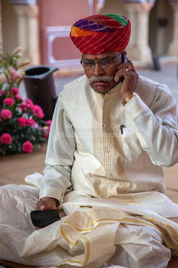 Jaipur, Rajasthan, India.  Hindu Priest Talking on his Cell Phone.