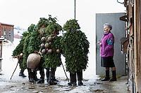 """Silvester Chlaeuse am 13. Januar 2012 unterwegs in und um Urnaesch in Appenzeller Aussenrhoden. """"die Schoenen, die Wuesten-Schoenen und die wuesten"""" Gruppen wuenschen den Einwohnern ein gutes neue Jahr ..On 13 January, «Old New Year's Eve», the «Chläuse» make their way around the Appenzell hinterland. ..Copyright © Zvonimir Pisonic"""